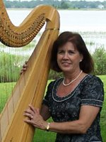 Judy McCoy with her Harp